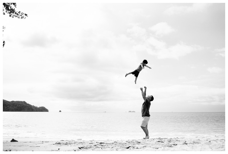Dad throwing his son in the air on the beach. Beach family photos in Playa Conchal Costa Rica. Photographed by Kristen M. Brown, Samba to the Sea Photography. Beach lifestyle photos in Costa Rica. Photographed by Kristen M. Brown, Samba to the Sea Photography.