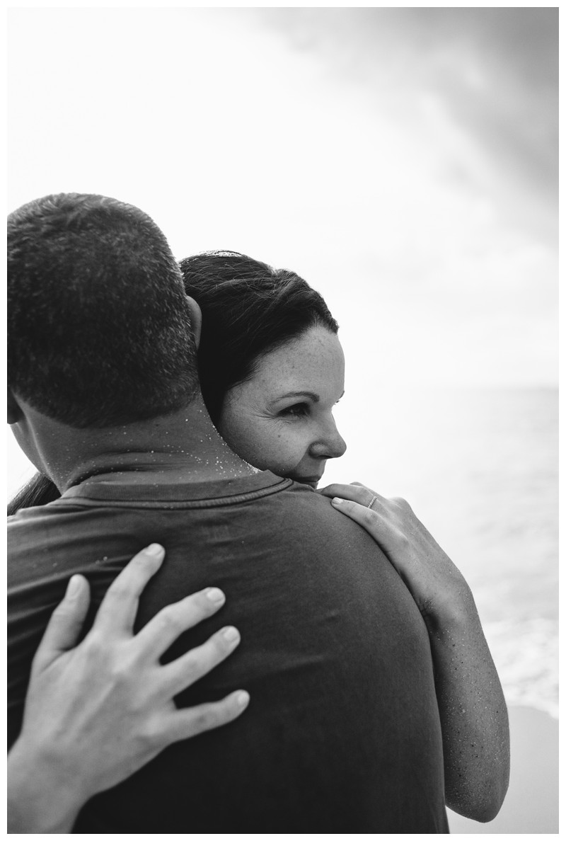 Husband and wife hugging on the beach. Beach family photos in Playa Conchal Costa Rica. Photographed by Kristen M. Brown, Samba to the Sea Photography. Beach lifestyle photos in Costa Rica. Photographed by Kristen M. Brown, Samba to the Sea Photography.