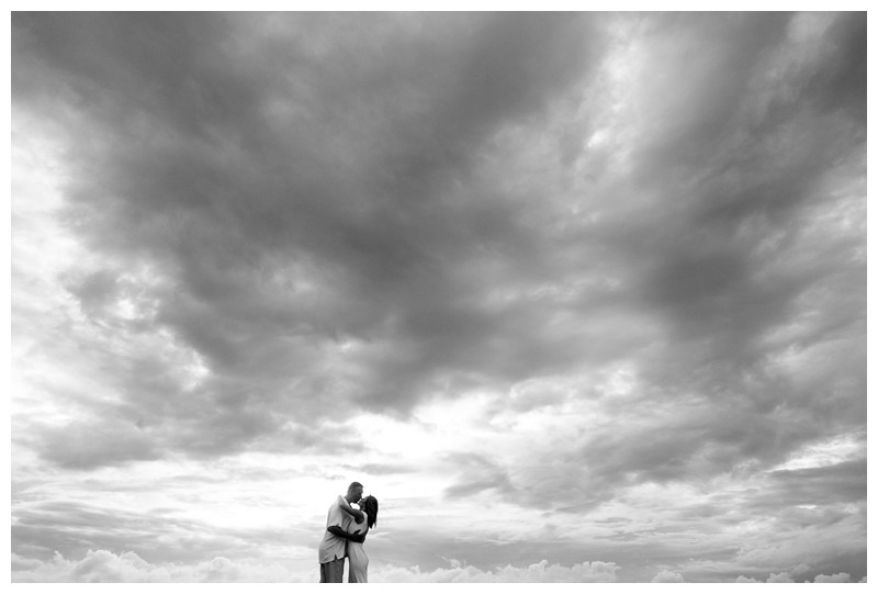Husband and wife kissing on the beach. Elopement on the Beach in Tamarindo Costa Rica. Photographed by Kristen M. Brown, Samba to the Sea Photography.