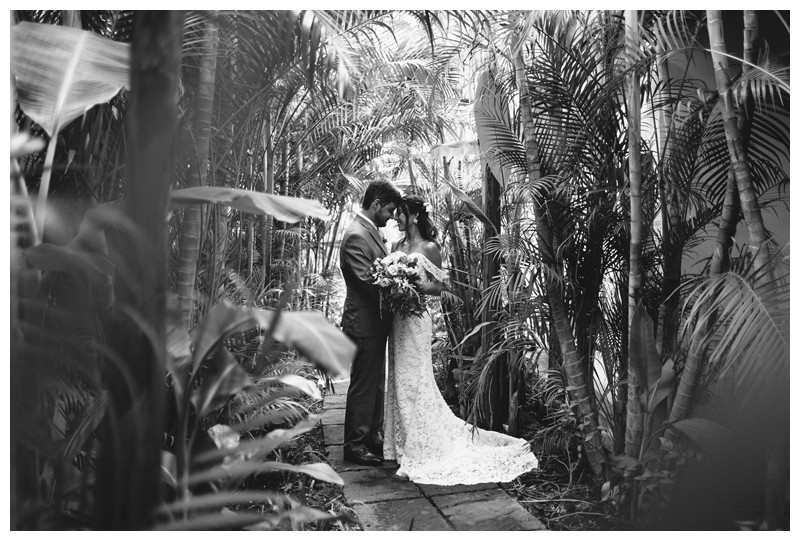 Bride + groom in a tropical jungle path. Elopement in Playa Langosta Costa Rica at Cala Luna Boutique Hotel + Villas. Photographed by Kristen M. Brown, Samba to the Sea Photography.