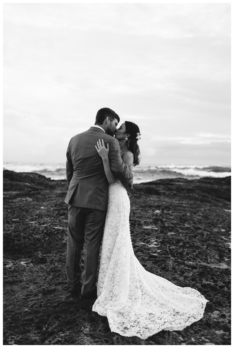 Bride + groom kissing on the beach in Playa Langosta. Elopement in Playa Langosta Costa Rica at Cala Luna Boutique Hotel + Villas. Photographed by Kristen M. Brown, Samba to the Sea Photography.