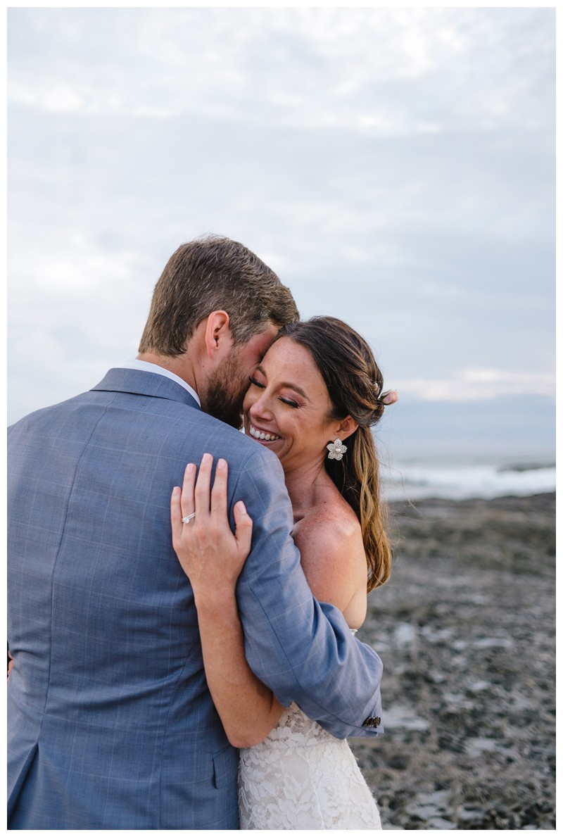 Bride + groom on the beach in Playa Langosta. Elopement in Playa Langosta Costa Rica at Cala Luna Boutique Hotel + Villas. Photographed by Kristen M. Brown, Samba to the Sea Photography.