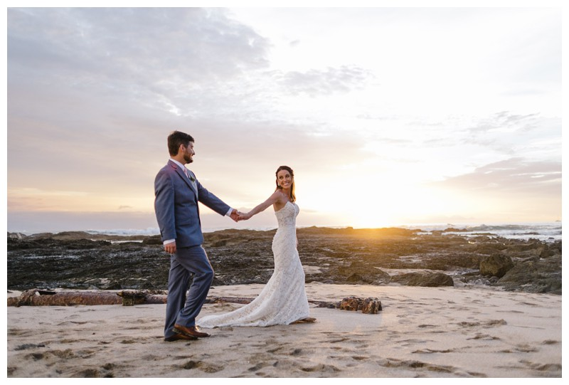 Bride + groom walking on the beach in Playa Langosta. Elopement in Playa Langosta Costa Rica at Cala Luna Boutique Hotel + Villas. Photographed by Kristen M. Brown, Samba to the Sea Photography.