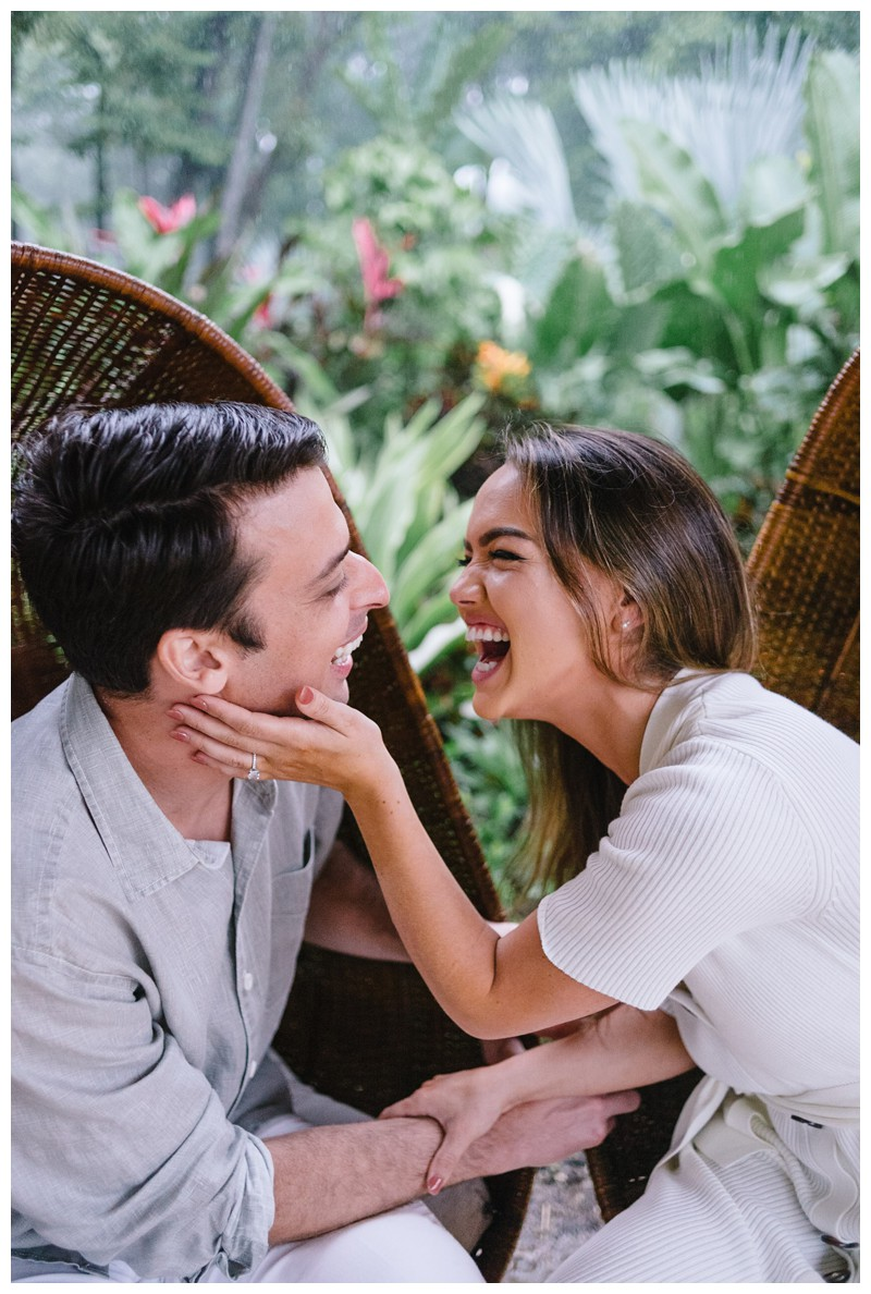 Couple laughing during engagement Photos in Nosara Costa Rica at The Guilded Iguana. Photographed by Kristen M. Brown, Samba to the Sea Photography.