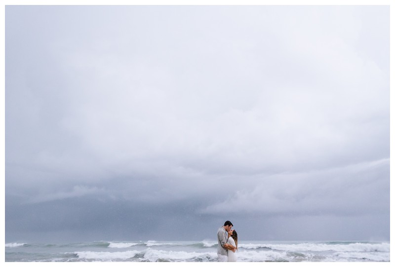 Couple kissing on the beach in Playa Guiones. Engagement Photos in Nosara Costa Rica. Photographed by Kristen M. Brown, Samba to the Sea Photography.