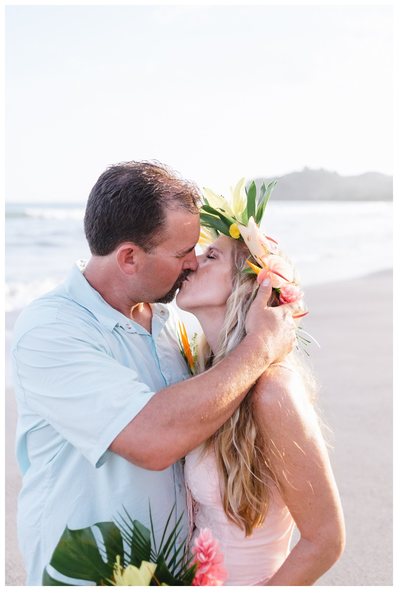 Husband and wife kissing on the beach after their vow renewal in Samara Costa Rica. Photographed by Kristen M. Brown, Samba to the Sea Photography.