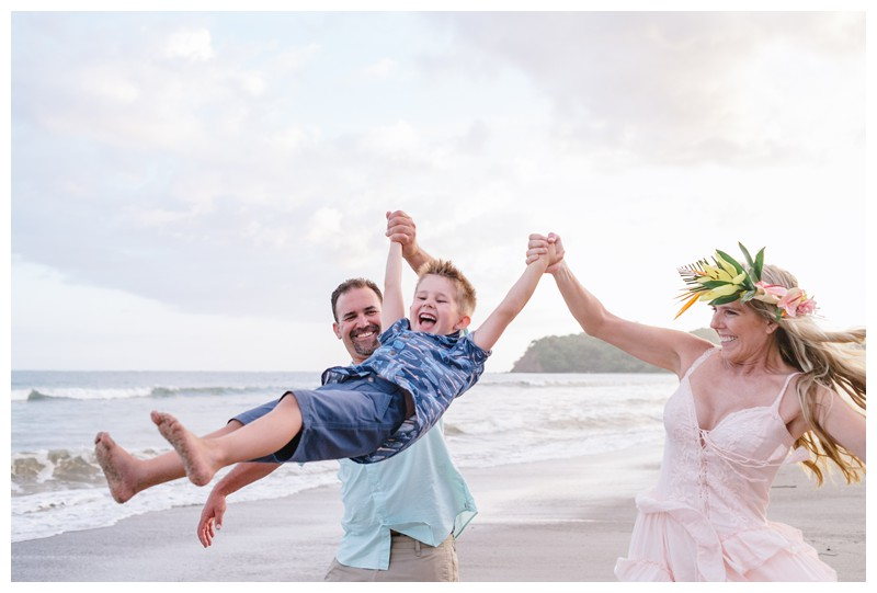 Family playing on the beach after their vow renewal in Samara Costa Rica. Photographed by Kristen M. Brown, Samba to the Sea Photography.