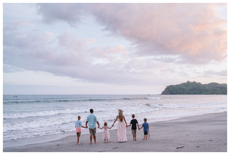 Family watching sunset on the beach after their vow renewal in Samara Costa Rica. Photographed by Kristen M. Brown, Samba to the Sea Photography.