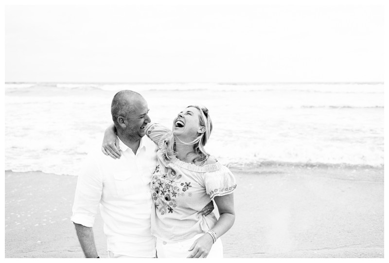 Mom and dad laughing on the beach in Nosara Costa Rica for family photos. Photographed by Kristen M. Brown, Samba to the Sea Photography.