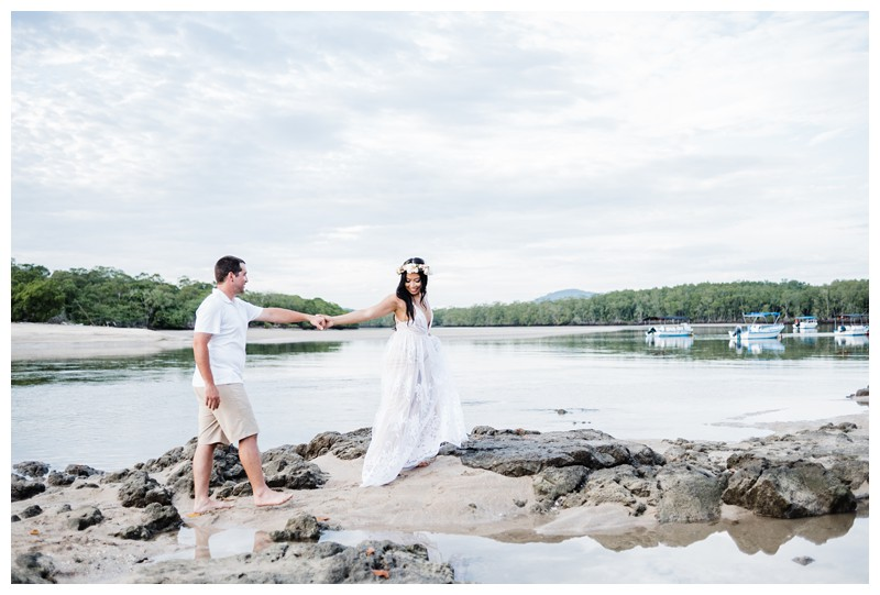 Couple walking on the beach during their honeymoon photos in Tamarindo Costa Rica. Photographed by Kristen M. Brown, Samba to the Sea Photography.