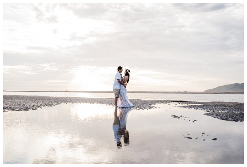 Couple kissing on the beach during their honeymoon photos in Tamarindo Costa Rica. Photographed by Kristen M. Brown, Samba to the Sea Photography.