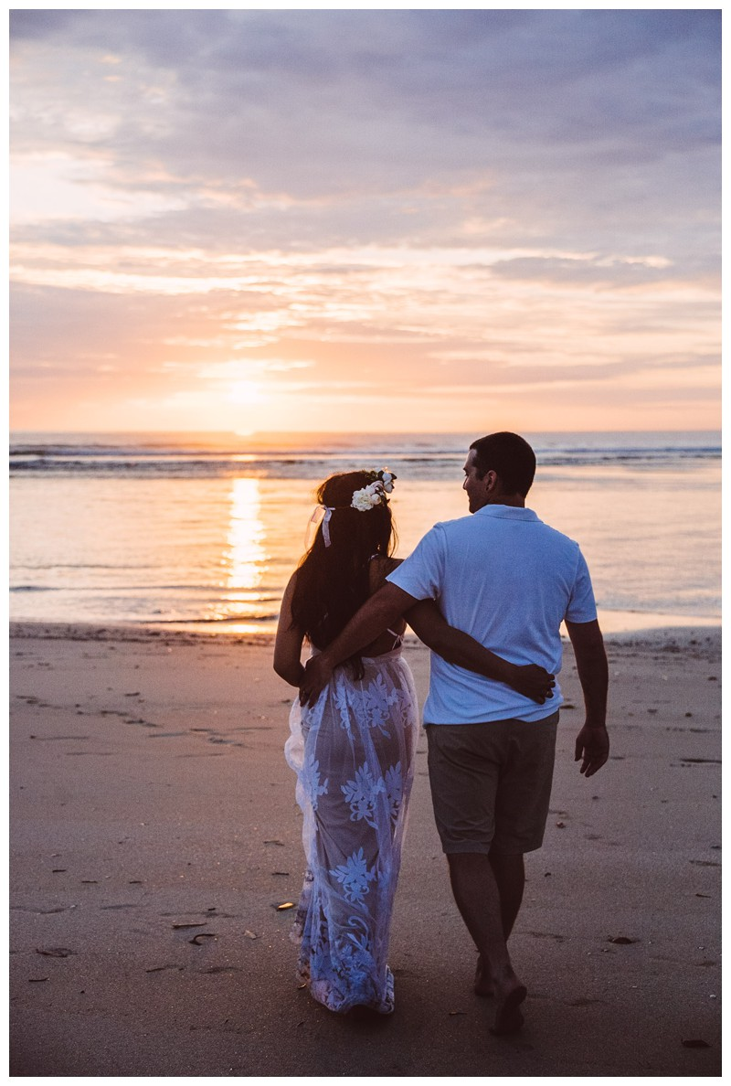 Couple walking on the beach during sunset on their honeymoon photos in Tamarindo Costa Rica. Photographed by Kristen M. Brown, Samba to the Sea Photography.