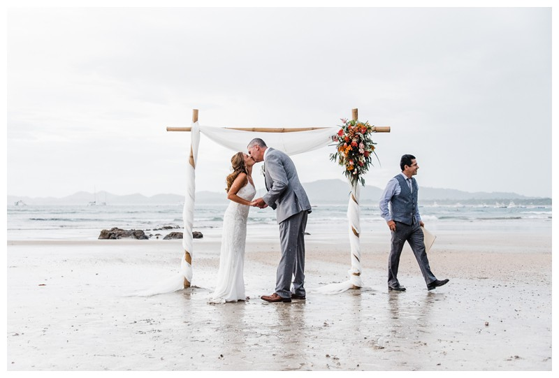 Bride and groom kissing on the beach. Sunset elopement in Tamarindo Costa Rica. Photographed by Kristen M. Brown, Samba to the Sea Photography.