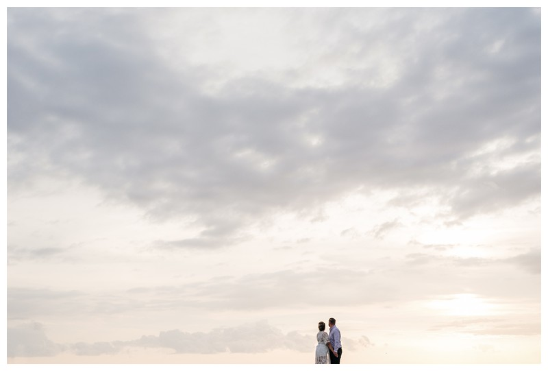 Bride and groom on the beach during sunset in Costa Rica. Beach Elopement in Playa Tamarindo, Costa Rica. Photographed by Kristen M. Brown, Samba to the Sea Photography.