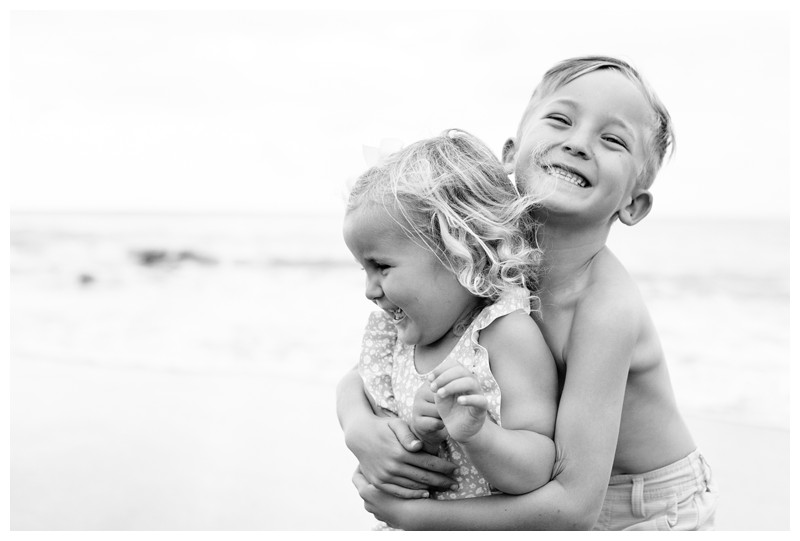 Brother and sister hugging on the beach. Family beach photos in Guanacaste Costa Rica. Photographed by Kristen M. Brown, Samba to the Sea Photography.
