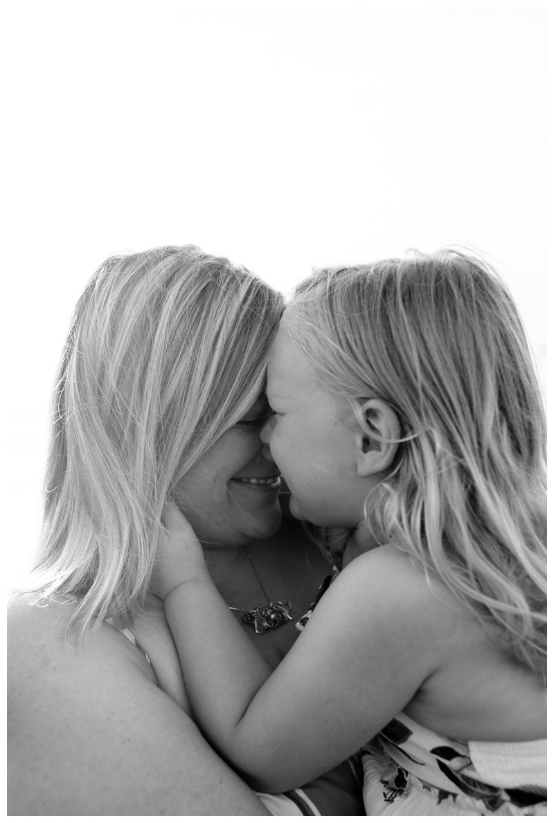 Mom and her daughter snuggling on the beach. Tamarindo Costa Rica beach family photos. Photographed by Kristen M. Brown, Samba to the Sea Photography. Beach lifestyle photos in Costa Rica. Photographed by Kristen M. Brown, Samba to the Sea Photography.