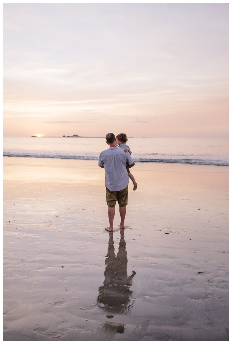 Dad holding his son during sunset on the beach. Tamarindo Costa Rica beach family photos. Photographed by Kristen M. Brown, Samba to the Sea Photography. Beach lifestyle photos in Costa Rica. Photographed by Kristen M. Brown, Samba to the Sea Photography.