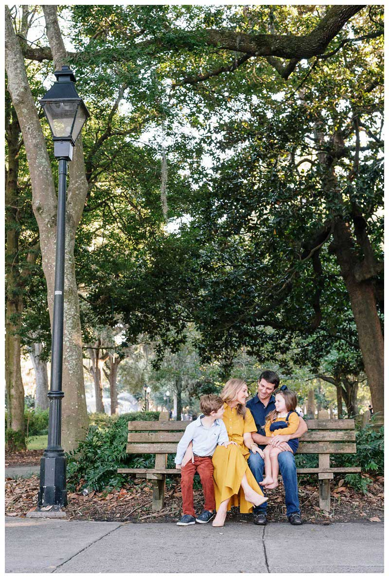 Family sitting on a park bench in Forsyth Park in Savannah, Georgia. Family photos in downtown Savannah Georgia. Photographed by Kristen M. Brown, Samba to the Sea Photography.