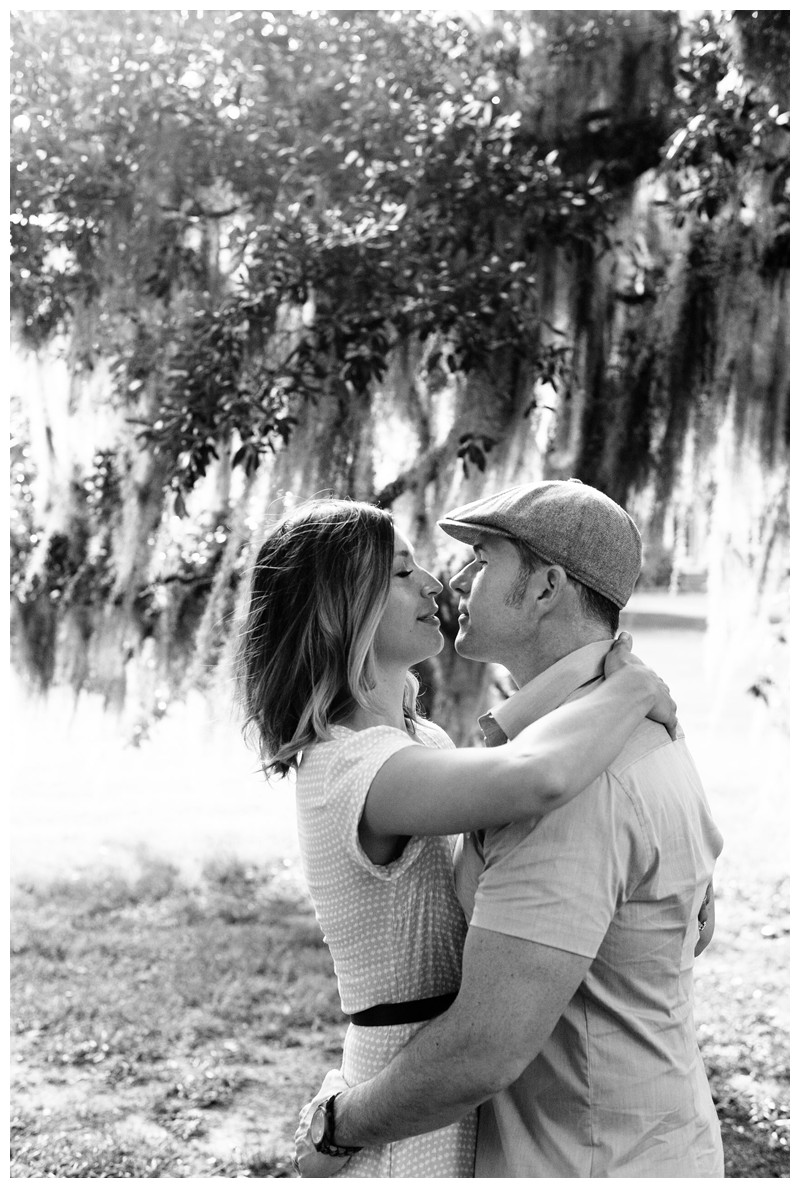 Husband and wife kissing under Oak trees. Ford Plantation Family Photos in Savannah, Georgia. Photographed by Kristen M. Brown, Samba to the Sea Photography.