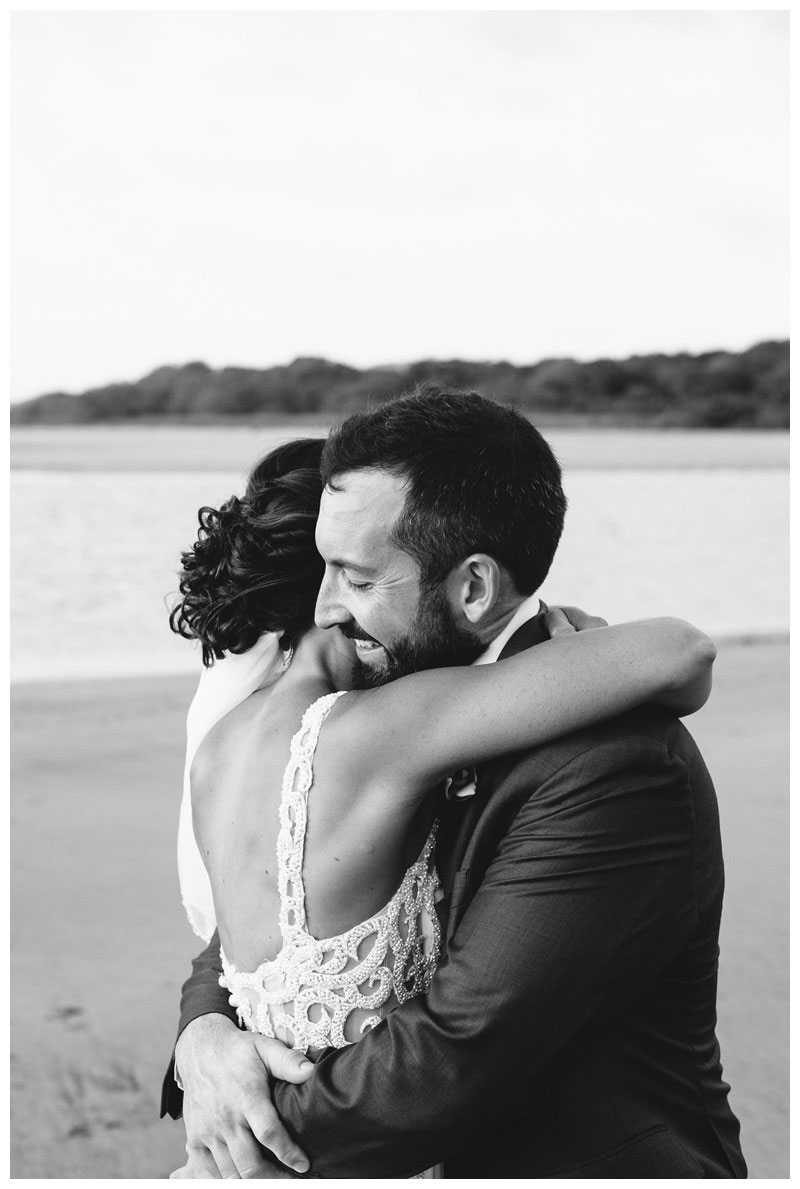 Bride and groom hugging on the beach during sunset. Tamarindo wedding at Casa Compass in Costa Rica. Photographed by Kristen M. Brown, Samba to the Sea Photography.