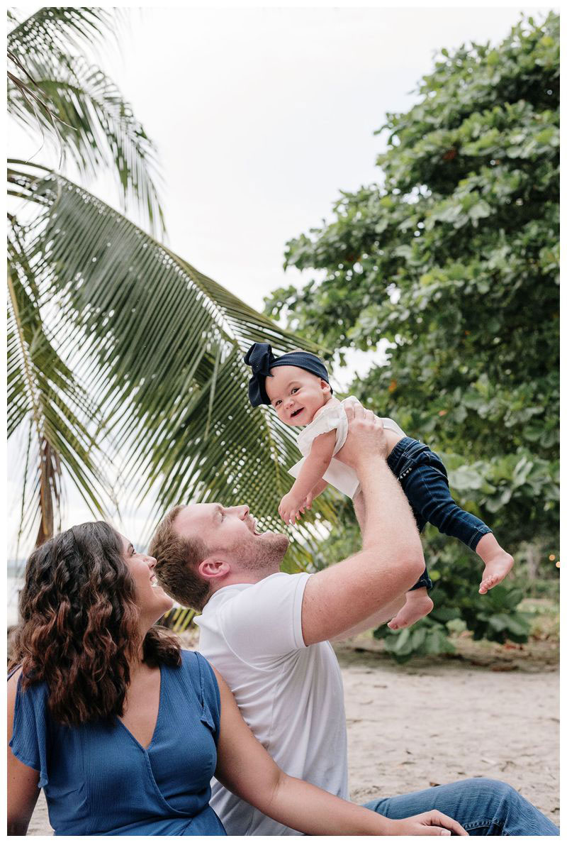 Baby girl laughing during beach family photos in Tamarindo Costa Rica. Photographed by Kristen M. Brown, Samba to the Sea Photography.
