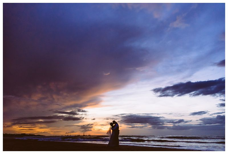 Bride and groom kissing on the beach during sunset in Costa Rica. Destination tropical wedding in Tamarindo, Costa Rica. Photographed by Kristen M. Brown, Samba to the Sea Photography.