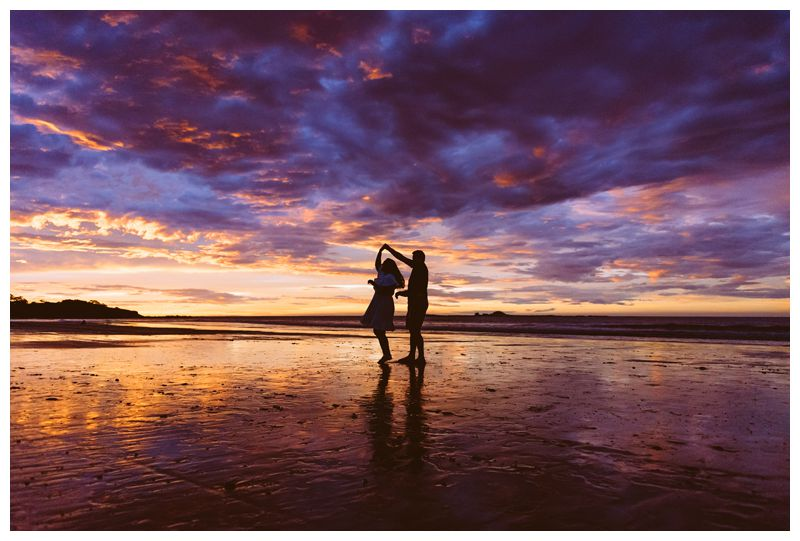 Bride and groom dancing at a beautiful sunset on the beach. Intimate beach wedding in Tamarindo Costa Rica. Photographed by Kristen M. Brown, Samba to the Sea Photography.