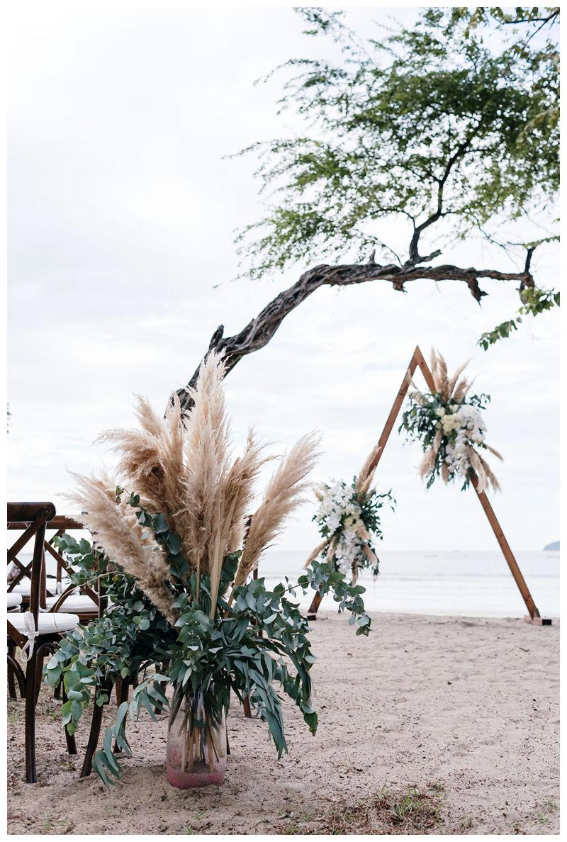 Pampas grass and orchid altar. Intimate beach wedding in Tamarindo Costa Rica. Photographed by Kristen M. Brown, Samba to the Sea Photography.