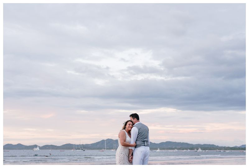 Bride and groom on the beach during sunset. Intimate beach wedding in Tamarindo Costa Rica. Photographed by Kristen M. Brown, Samba to the Sea Photography.