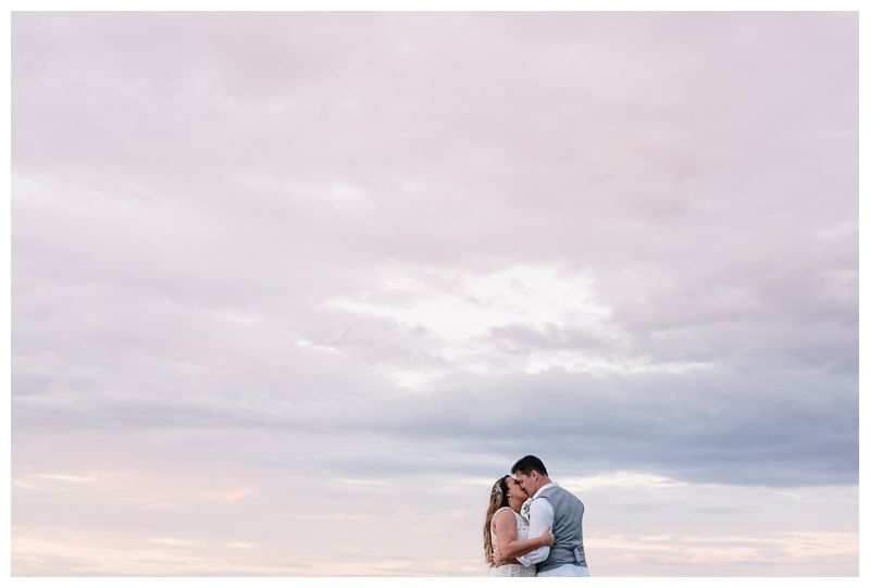 Bride and groom kissing on the beach during sunset. Intimate beach wedding in Tamarindo Costa Rica. Photographed by Kristen M. Brown, Samba to the Sea Photography.