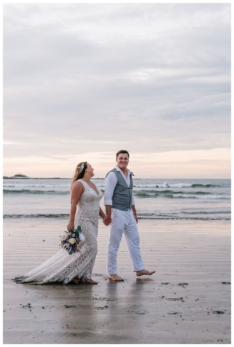 Bride and groom walking on the beach during sunset. Intimate beach wedding in Tamarindo Costa Rica. Photographed by Kristen M. Brown, Samba to the Sea Photography.