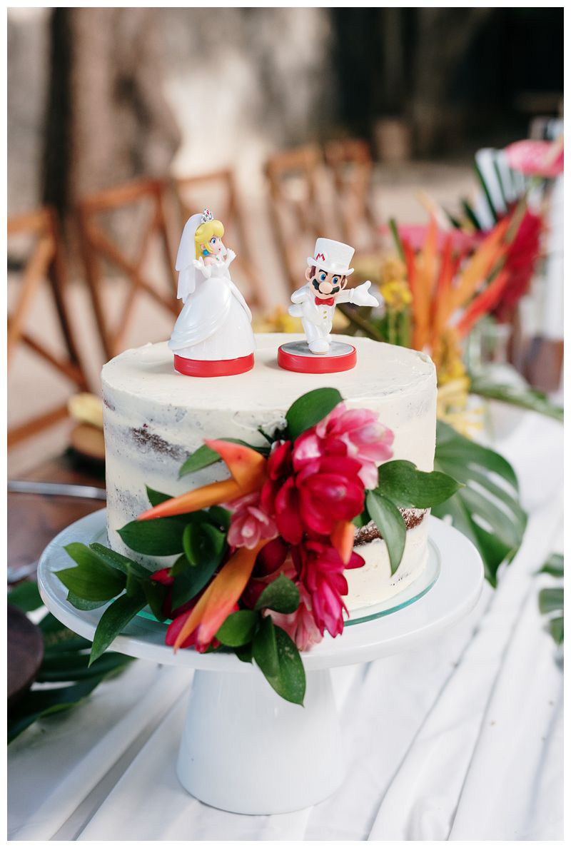 Mario and Princess Peach wedding cake toppers. Tropical intimate destination beach wedding in Tamarindo Costa Rica. Photographed by Kristen M. Brown, Samba to the Sea Photography.