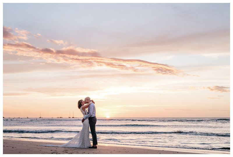 Bride and groom kissing on the beach during a beautiful sunset. Intimate destination beach wedding in Tamarindo Costa Rica. Photographed by Kristen M. Brown, Samba to the Sea Photography.