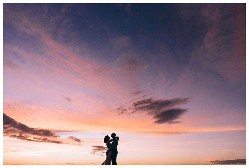 Bride and groom on the beach during a beautiful sunset. Intimate destination beach wedding in Tamarindo Costa Rica. Photographed by Kristen M. Brown, Samba to the Sea Photography.