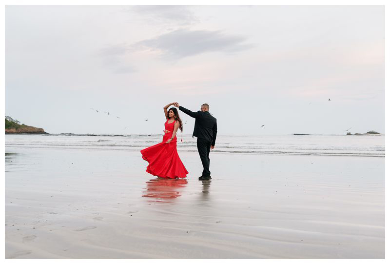 Boyfriend dancing on the beach. Sunrise beach engagement photos in Tamarindo Costa Rica. Photographed by Kristen M. Brown, Samba to the Sea Photography.