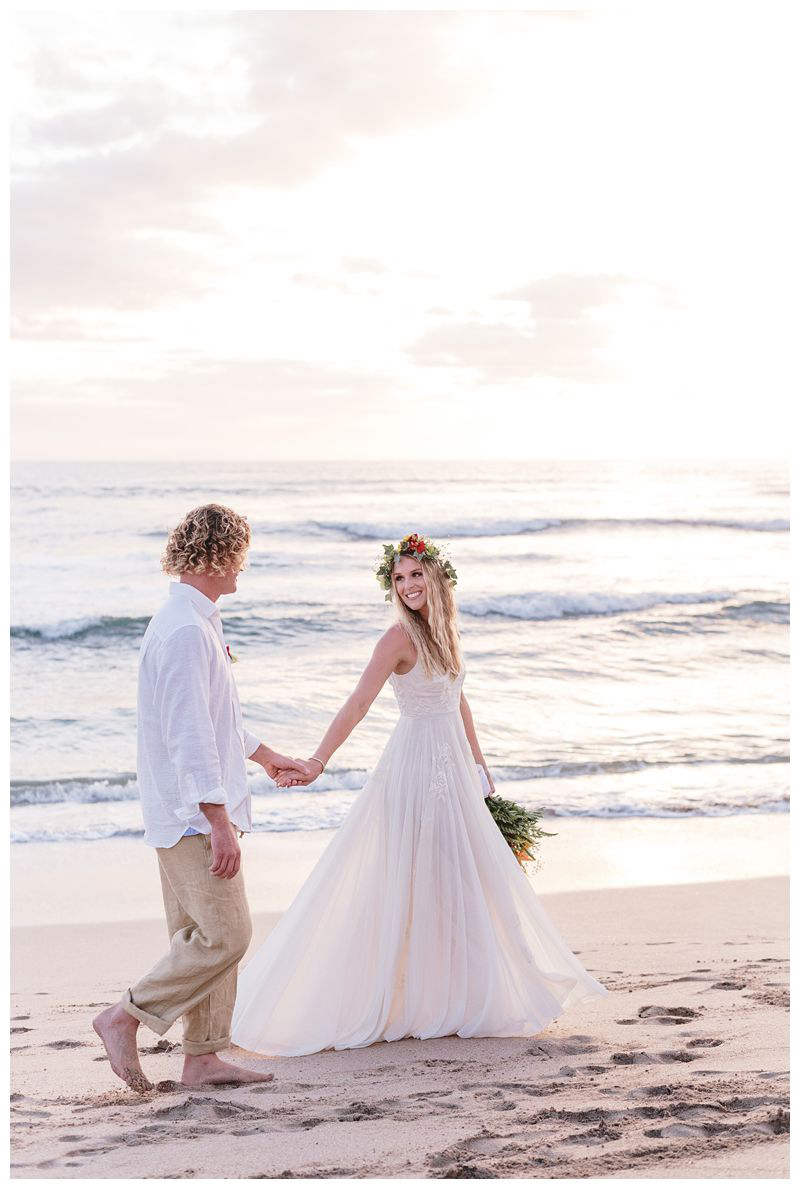 Bride and groom walking on the beach. Intimate destination wedding at Lagarta Lodge in Playa Pelada Costa Rica. Photographed by Kristen M. Brown, Samba to the Sea Photography.