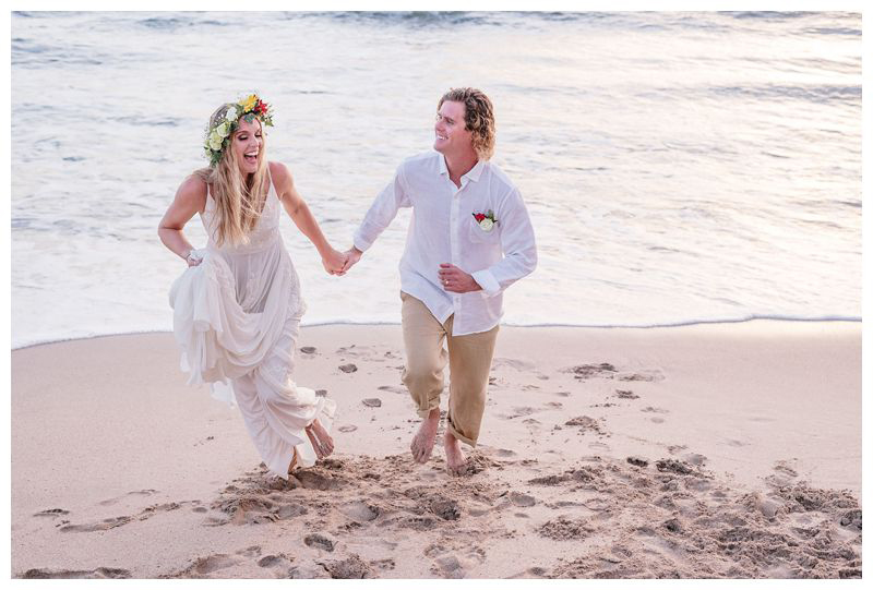 Bride and groom running on the beach. Intimate destination wedding at Lagarta Lodge in Playa Pelada Costa Rica. Photographed by Kristen M. Brown, Samba to the Sea Photography.