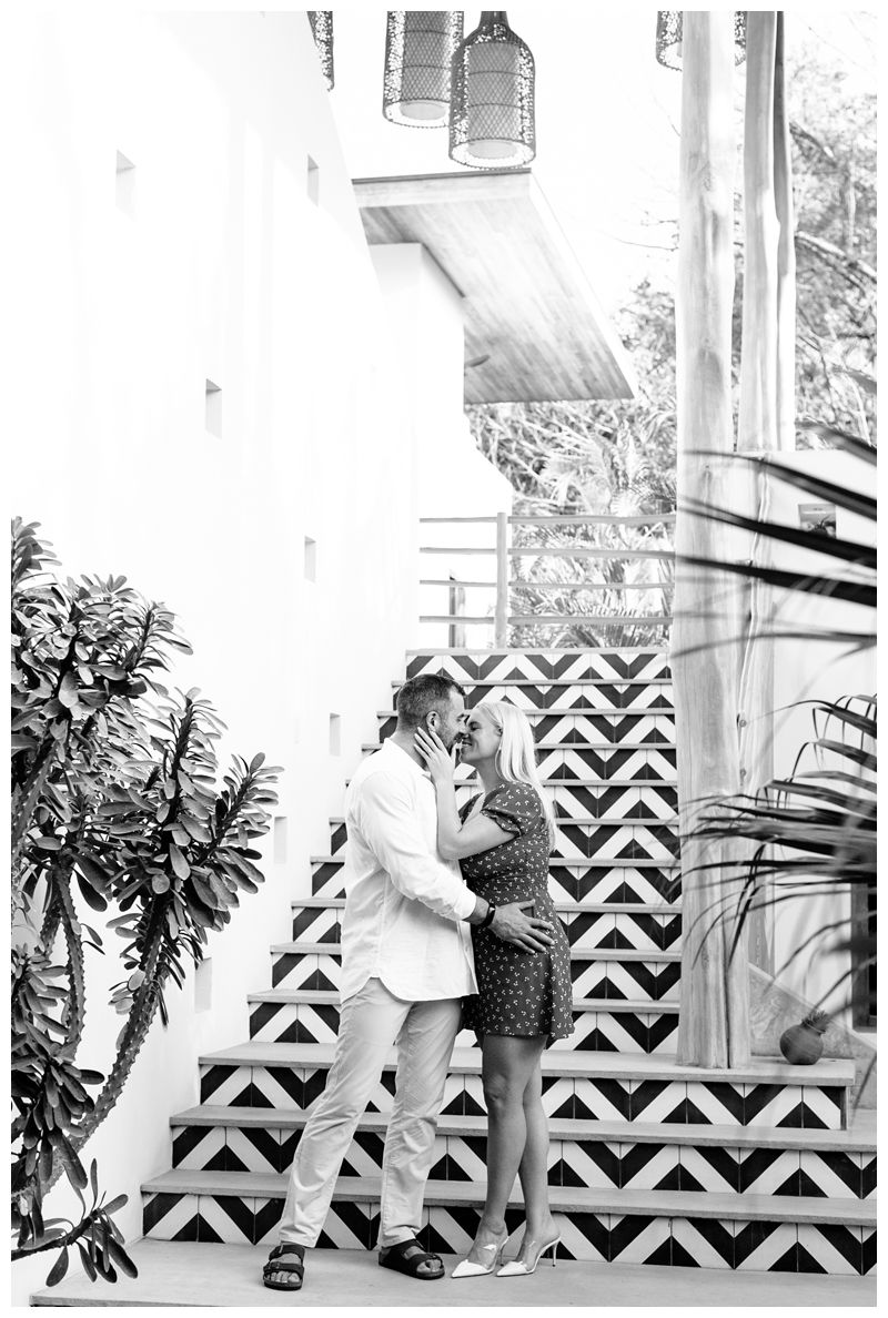 Couple kissing at The Nomadic Hotel in Nosara. Playa Guiones Costa Rica engagement photos. Photographed by Kristen M. Brown, Samba to the Sea Photography.