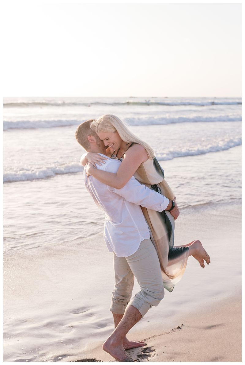 Couple on the beach in Noara. Playa Guiones Costa Rica engagement photos. Photographed by Kristen M. Brown, Samba to the Sea Photography.