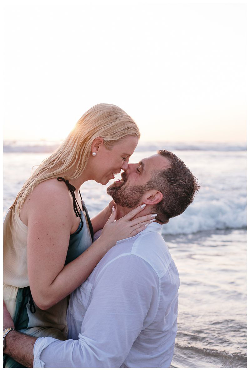 Couple kissing on the beach in Noara. Playa Guiones Costa Rica engagement photos. Photographed by Kristen M. Brown, Samba to the Sea Photography.