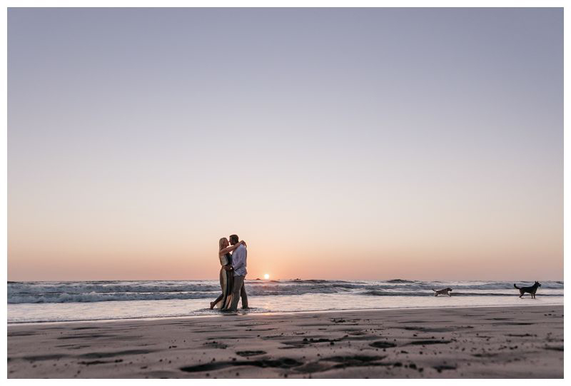 Couple kissing during sunset on the beach in Noara. Playa Guiones Costa Rica engagement photos. Photographed by Kristen M. Brown, Samba to the Sea Photography.