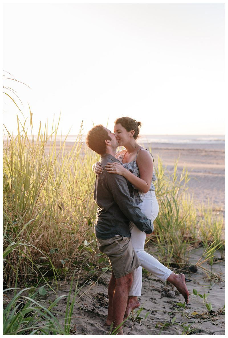 Couple kissing on the beach. Proposal on the beach in Tamarindo Costa Rica. Photographed by Kristen M. Brown, Samba to the Sea Photography.