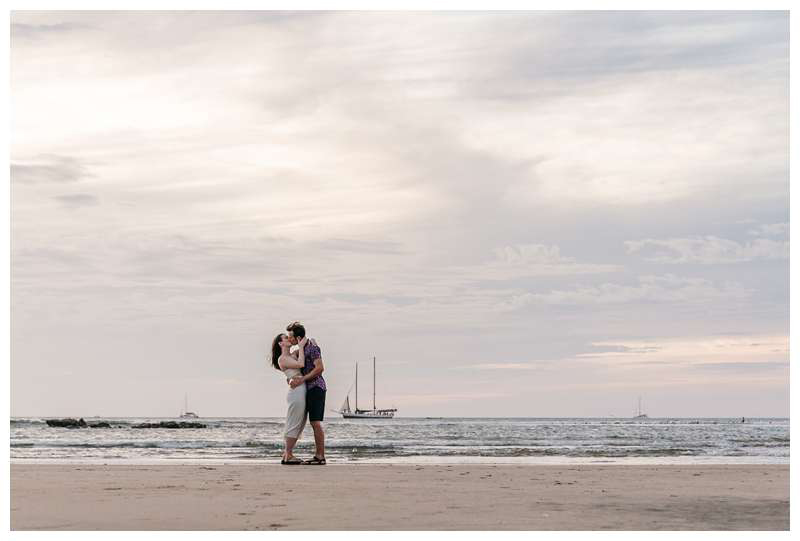 Couple kissing during sunset on the beach. Engagement photos on the beach. Romantic proposal on the beach in Tamarindo Costa Rica. Photographed by Kristen M. Brown, Samba to the Sea Photography.