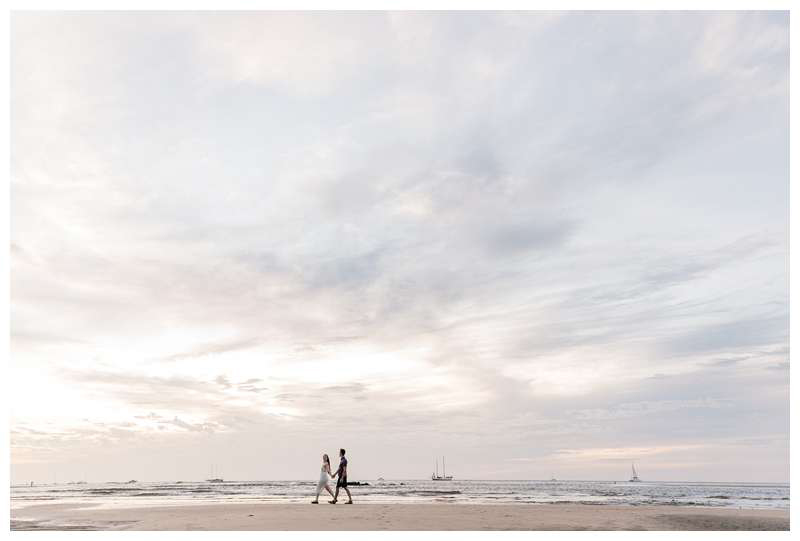 Couple walking during sunset on the beach. Engagement photos on the beach. Romantic proposal on the beach in Tamarindo Costa Rica. Photographed by Kristen M. Brown, Samba to the Sea Photography.