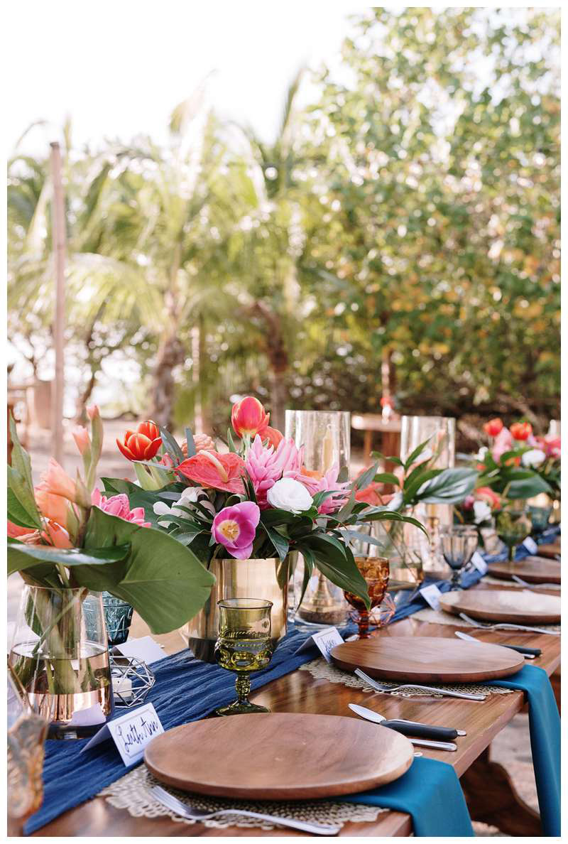Tropical wedding flowers. Intimate beach wedding in Costa Rica at Casa Mar Azul in Hacienda Pinilla. Photographed by Kristen M. Brown, Samba to the Sea Photography.