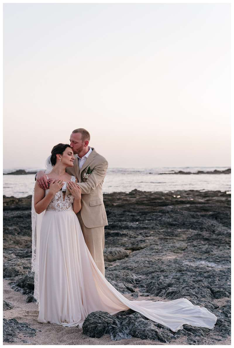 Bride and groom on the beach after their destination beach wedding. Intimate beach wedding in Costa Rica at Casa Mar Azul in Hacienda Pinilla. Photographed by Kristen M. Brown, Samba to the Sea Photography.
