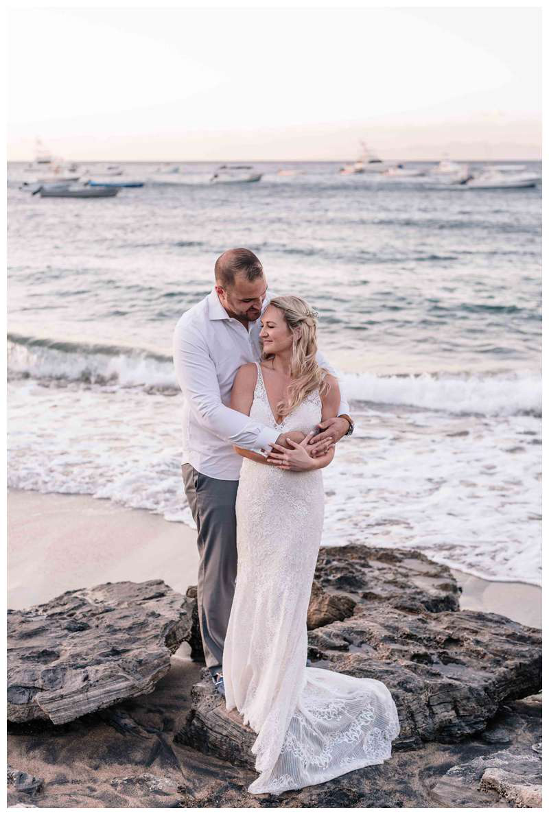 Bride and groom on the beach after their intimate wedding in Playa Ocotal Costa Rica. Photographed by Kristen M. Brown, Samba to the Sea Photography.