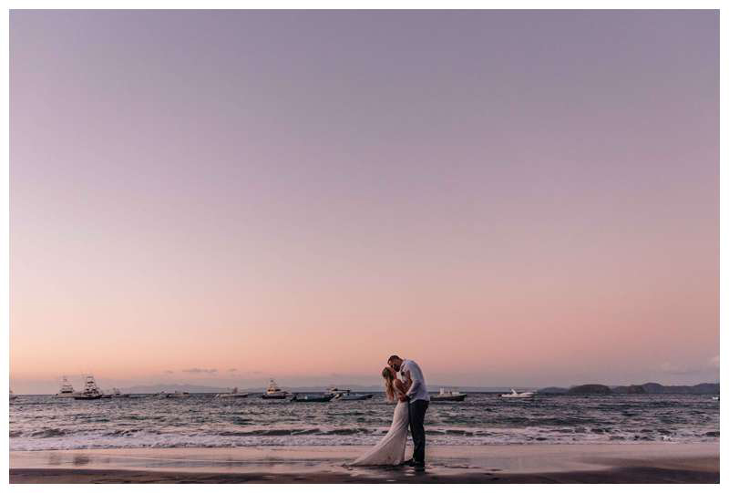 Bride and groom kissing on the beach at sunset after their intimate wedding in Playa Ocotal Costa Rica. Photographed by Kristen M. Brown, Samba to the Sea Photography.