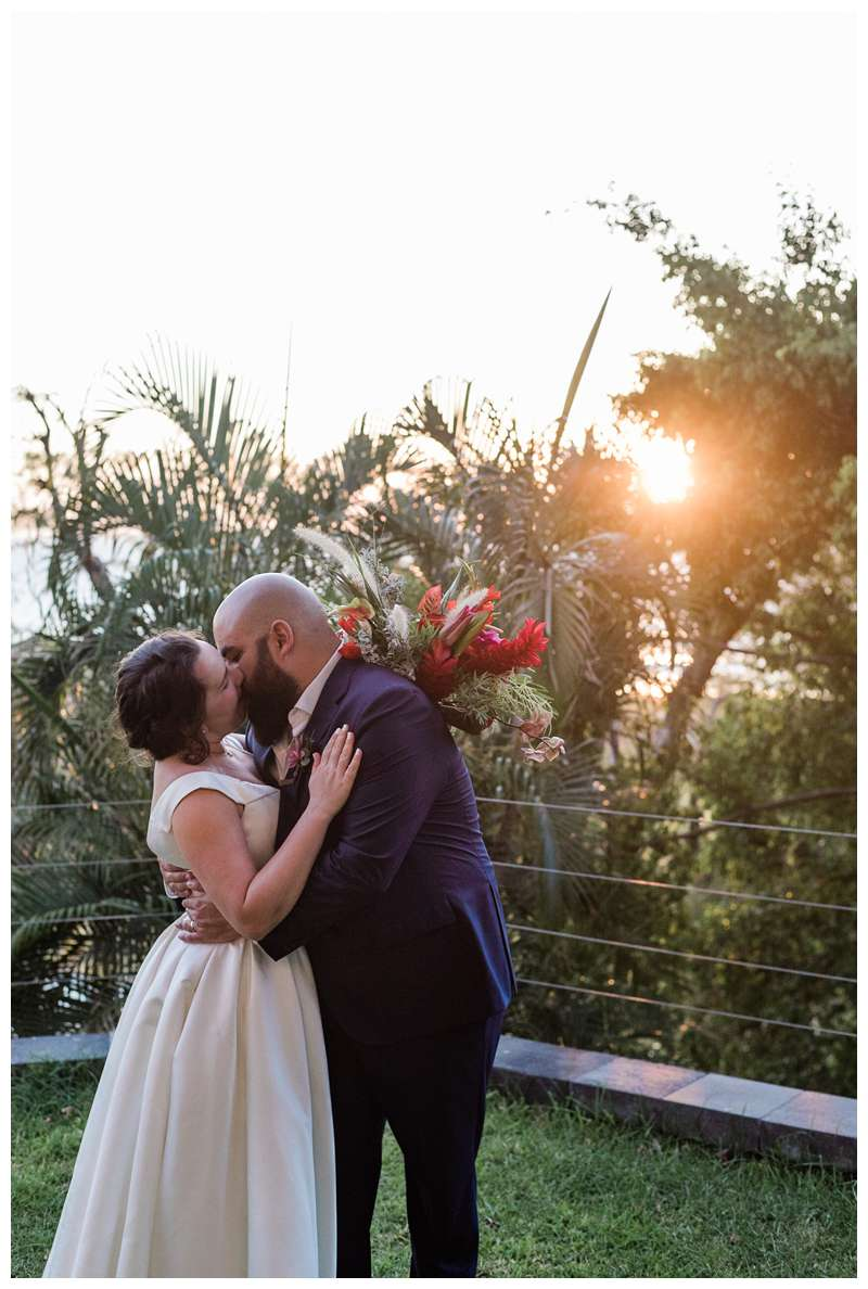 Bride and groom kissing at their intimate wedding in Tamarindo Costa Rica at Alang Alang. Photographed by Kristen M. Brown, Samba to the Sea Photography.