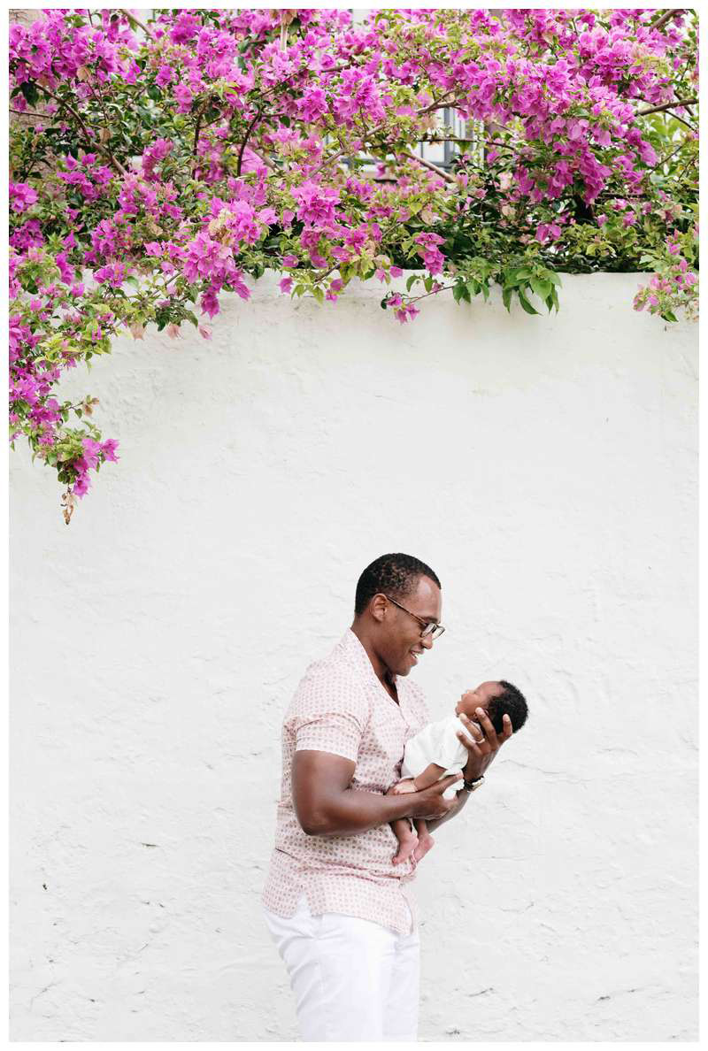 Dad smiling holding his baby girl. Baby's first photos in Coral Gables, FL. Photographed by Kristen M. Brown, Samba to the Sea Photography.